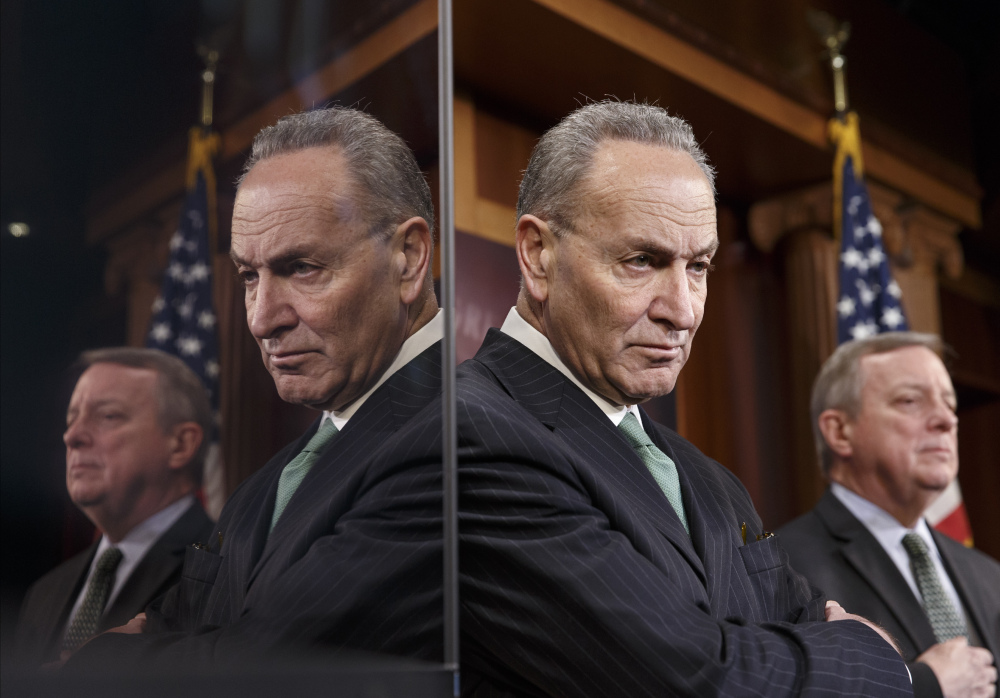 Sen. Charles Schumer, D-N.Y., the Democratic Policy Committee chairman, left, and Senate Majority Whip Richard Durbin of Illinois are reflected in a TV monitor as they talk to reporters about efforts pass a bill to extend unemployment benefits on Thursday during a news conference on Capitol Hill in Washington.