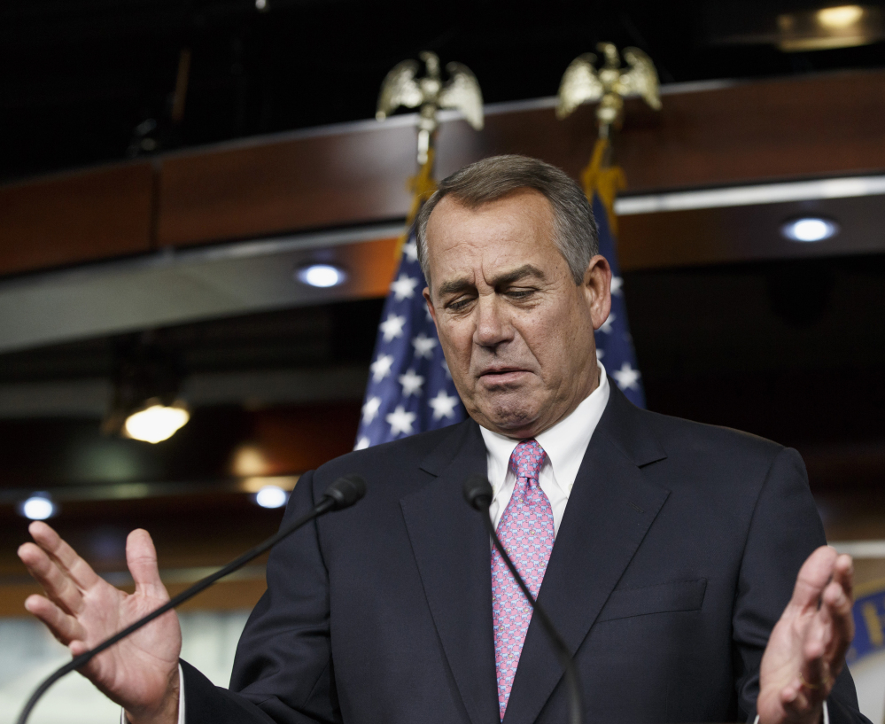 House Speaker John Boehner of Ohio speaks during a news conference on Capitol Hill in Washington on Thursday.