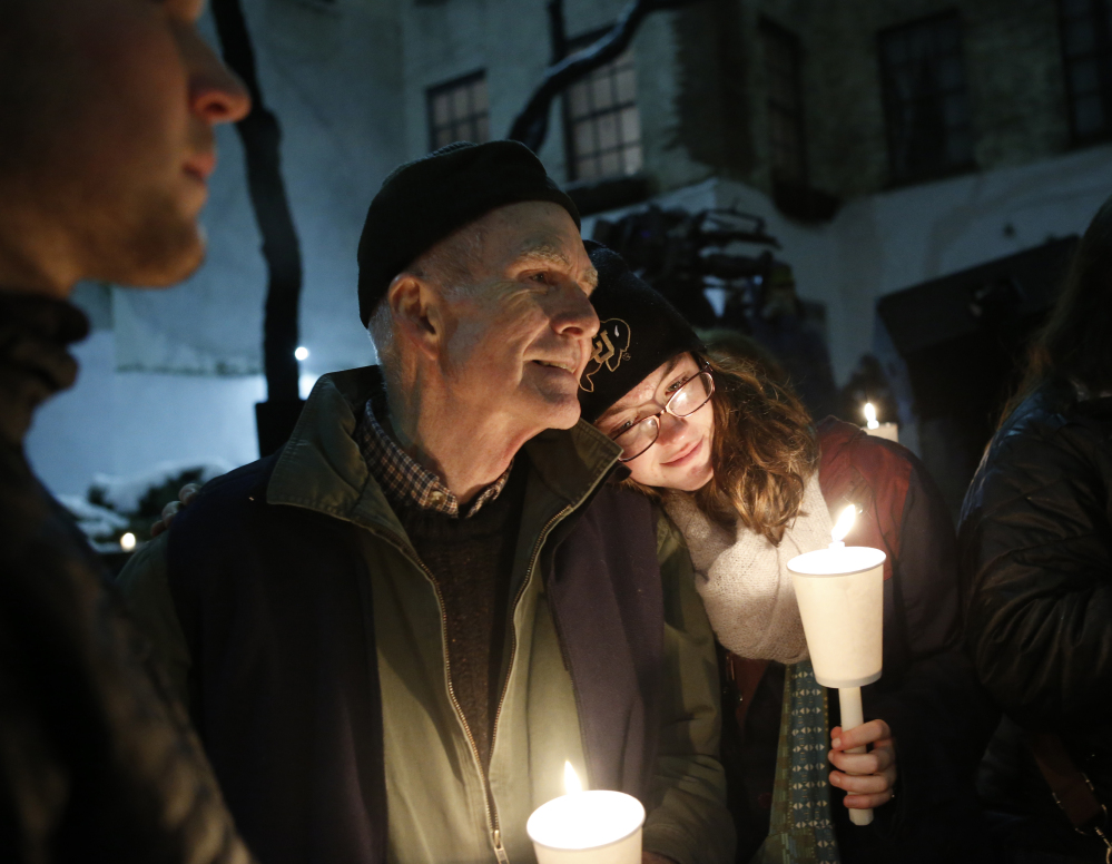 People hold candles during a candlelight vigil and remembrance for actor Philip Seymour Hoffman that was held Wednesday night in the courtyard behind the Labyrinth Theater Company on Bank Street. Hoffman was a member and former artistic director of Labyrinth.