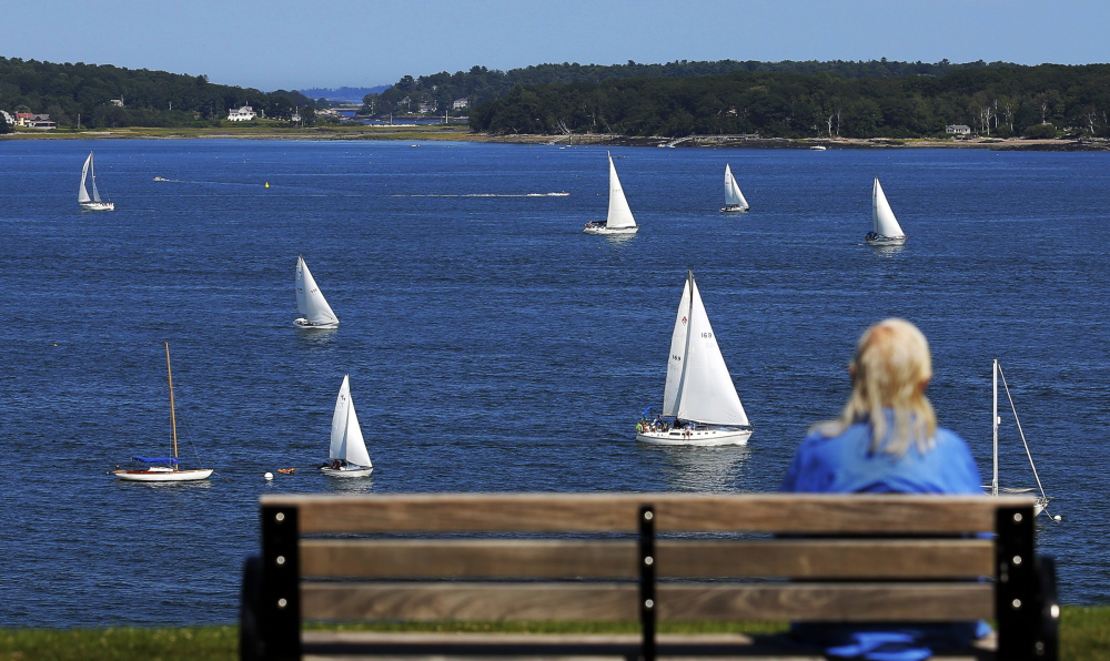 """Dolores Wilhoite of Portland watches the MS Regatta from the Eastern Promenade last August. """"The smogless skies make Portland the healthiest urban center in the states,"""" according to Green Living magazine."""