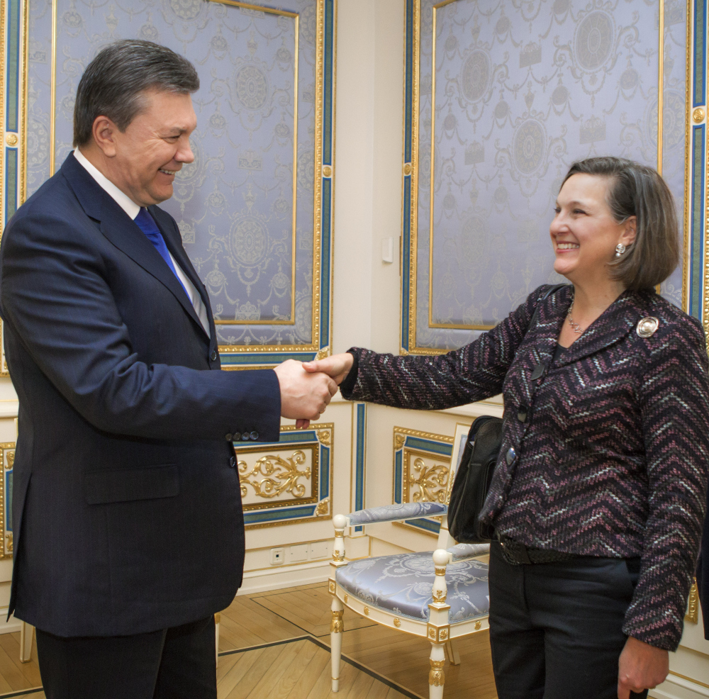 Ukraine's President Viktor Yanukovych greets U.S. Assistant Secretary for European and Eurasian Affairs Victoria Nuland in Kiev, Ukraine, Thursday. The senior U.S. diplomat is in the Ukrainian capital to try to help find a resolution to the protests and political crisis that have gripped the country for more than two months.