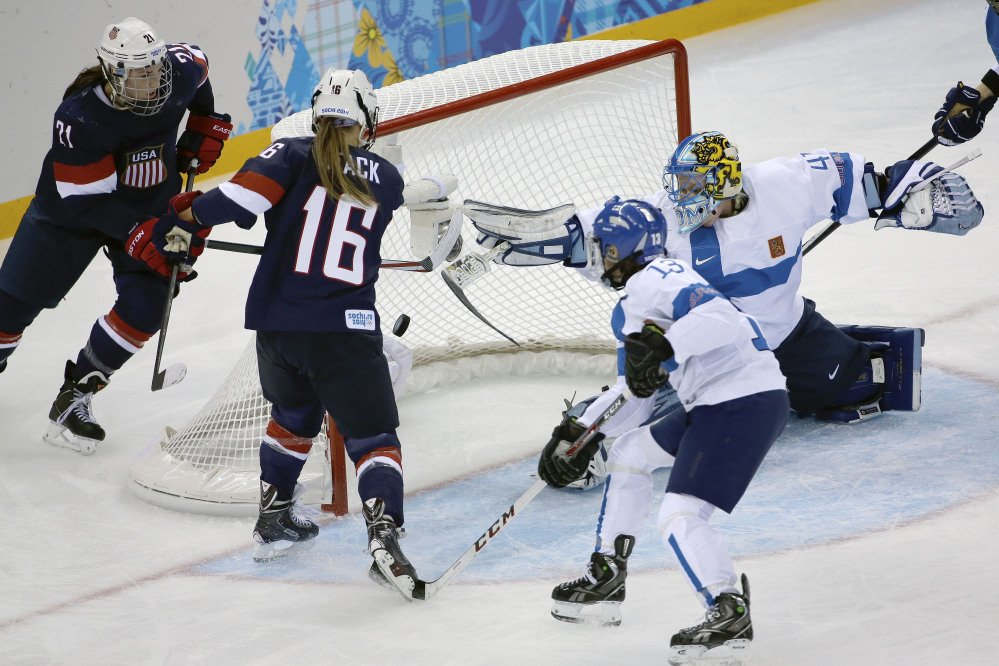 Kelli Stack of the Untied States, 16, scores a goal on an assist from Hilary Knight, 21, of the Untied States as goalkeeper Noora Raty of Finland tries to block the shot during the second period.