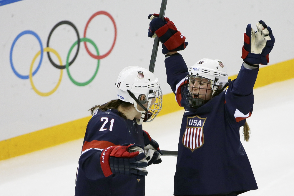 Kelli Stack of the Untied States celebrates her goal with teammate Hilary Knight during the second period of the 2014 Winter Olympics women's hockey game against Finland at Shayba Arena on Saturday.