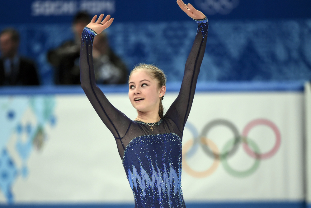 Yulia Lipnitskaya ,of Russia, waves after competing in the women's team short program figure skating competition at the Iceberg Skating Palace during the 2014 Winter Olympics, Saturday, in Sochi, Russia.