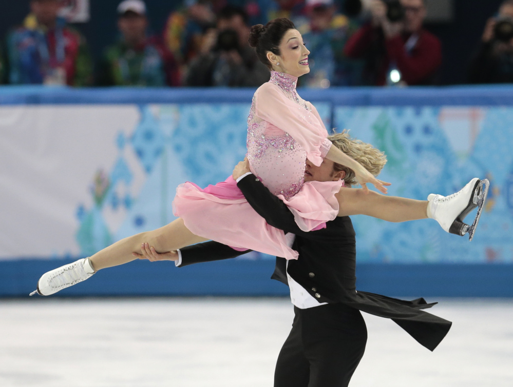 Meryl Davis and Charlie White of the United States compete in the team ice dance short dance figure skating competition at the Iceberg Skating Palace during the 2014 Winter Olympics on Saturday Sochi, Russia.