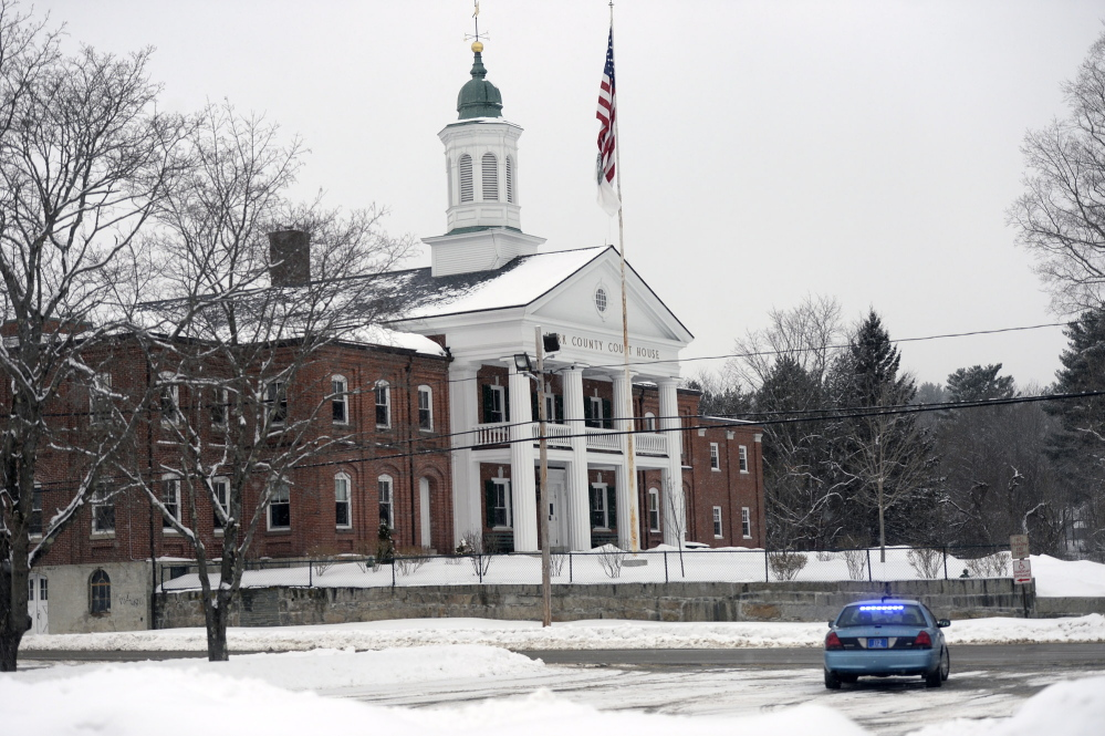 A Maine State Police car parks in front of the York County Courthouse in Alfred on Monday while police investigate a bomb threat.