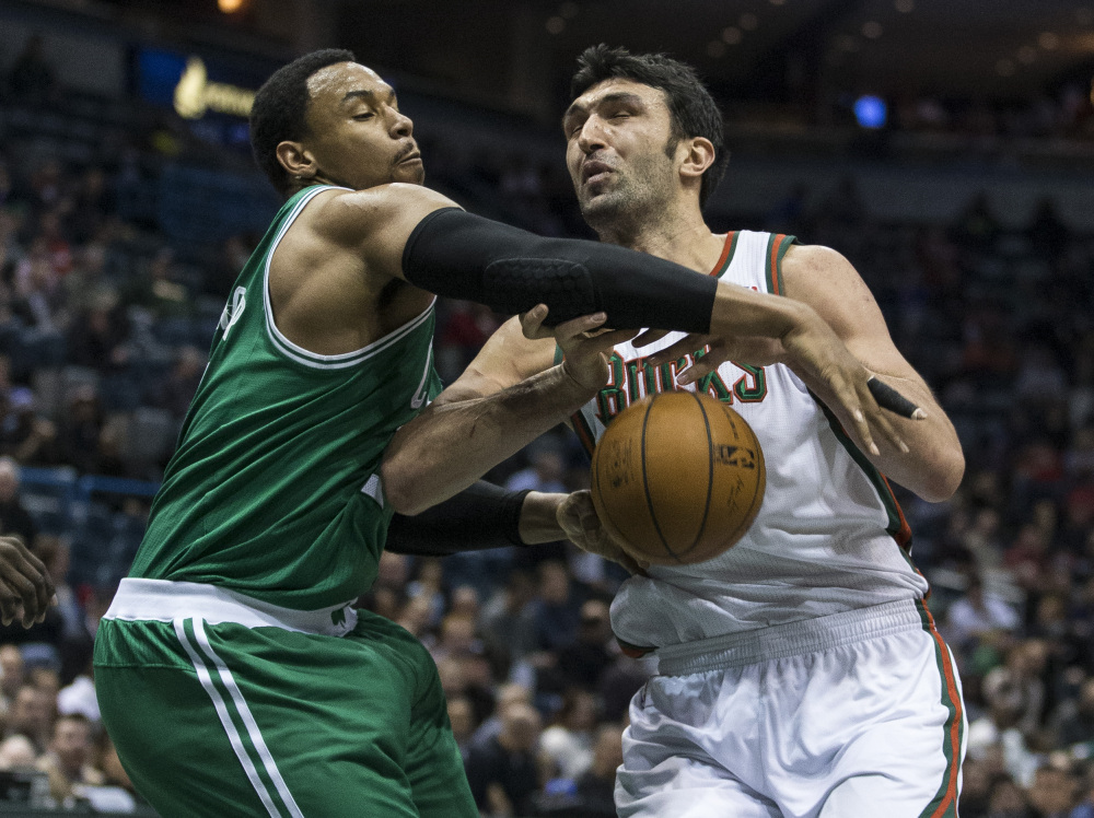 STUFFED: Boston Celtics' Jared Sullinger, left, strips the ball from Milwaukee Bucks' Zaza Pachulia during the second half Monday in Milwaukee. The Celtics won 102-86.