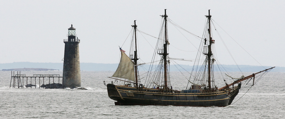 "The Bounty motors past Ram Island Ledge Lighthouse off Cape Elizabeth. The 108-foot-long, three-masted ship was a replica of the 18th-century British ship HMS Bounty. It was built in 1960 for the movie ""Mutiny on the Bounty"" and appeared in several other films, including one ""Pirates of the Caribbean"" movie."