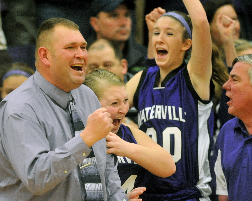 Staff photo by Michael G. Seamans HIGH SCHOOL BASKETBALL: Waterville Senior High School head basketball coach Rob Rodrigue celebrates an upset victory over number 4 ranked Winslow High School 42-34 in Winslow on Tuesday.