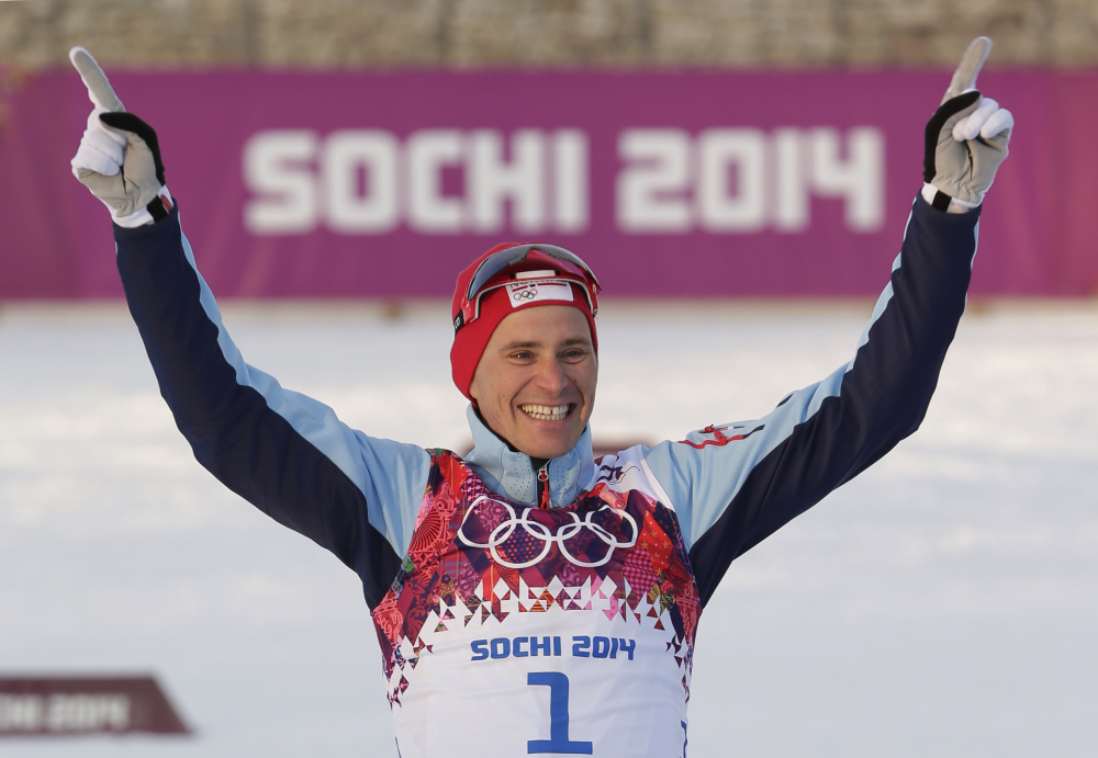 Norway's Ola Vigen Hattestad celebrates winning the gold medal during the flower ceremony for the men's cross-country sprint at the 2014 Winter Olympics, Tuesday in Krasnaya Polyana, Russia.