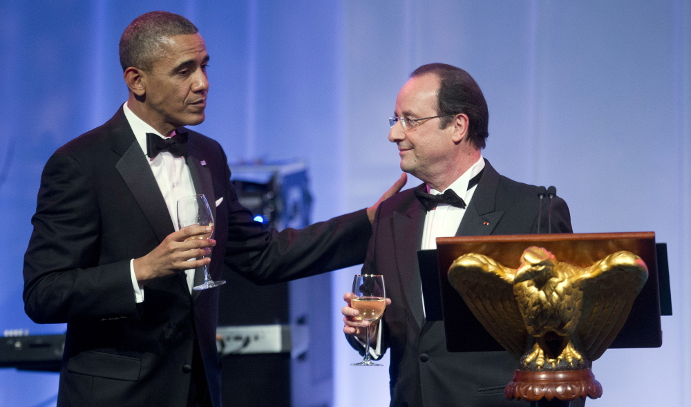 President Obama completes his toast to French President Francois Hollande at a White House state dinner on Tuesday.