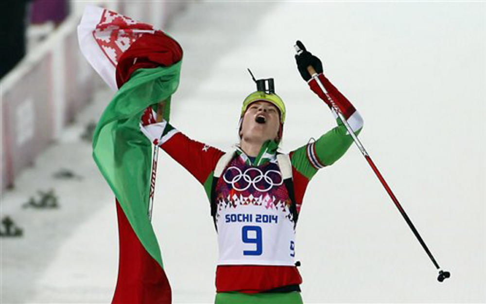 Belarus' Darya Domracheva celebrates after winning the gold medal in the women's biathlon 10k pursuit, at the 2014 Winter Olympics Tuesday in Krasnaya Polyana, Russia.