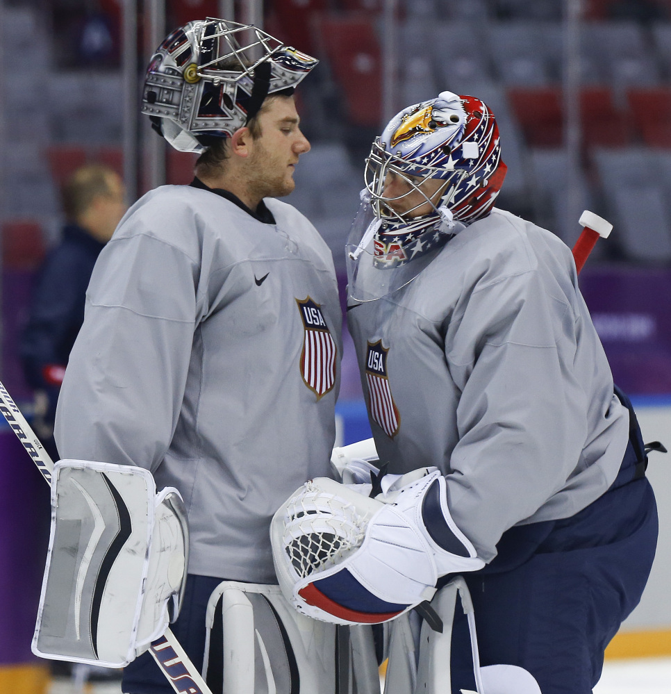 USA goaltender Jonathan Quick, left, talks with goaltender Jimmy Howard during a training session in Sochi, Russia.