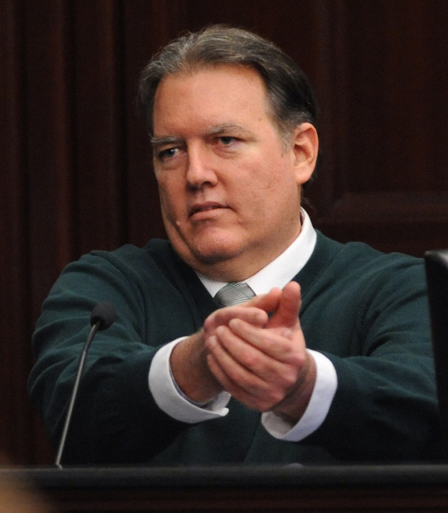 Michael Dunn, gestures on the stand in his own defense during his trial in Jacksonville, Fla., Tuesday.
