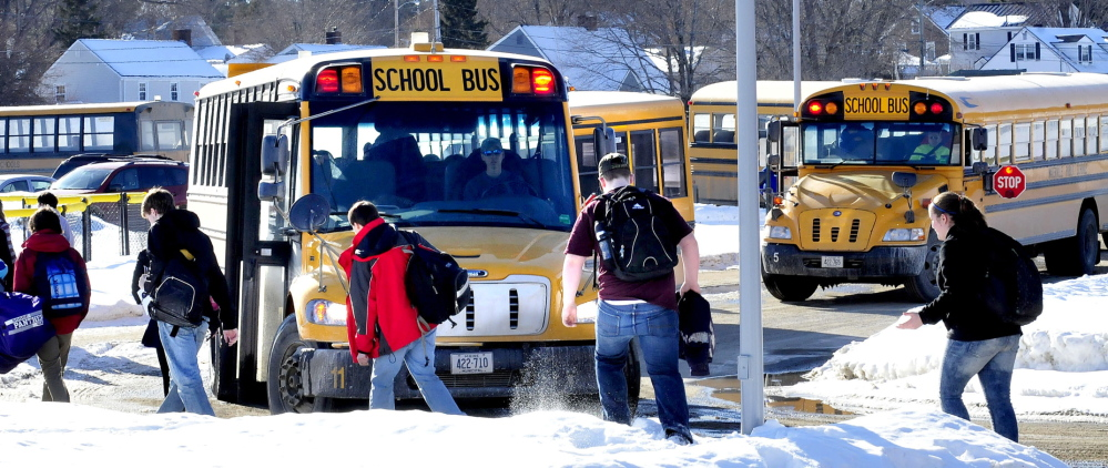 SNOW DAYS: Students board school buses Wednesday at Waterville Senior High School. They may get a break from school this Friday because a snowstorm, predicted to start Thursday afternoon, but that decision will be based on detailed forecasts sought by the superintendent.
