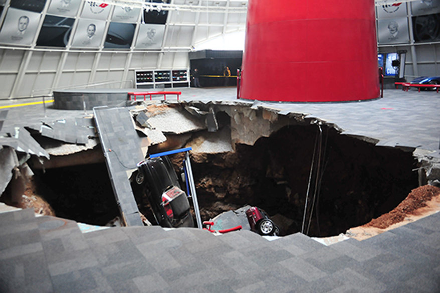 In this image provided by the National Corvette Museum shows several cars that collapsed into a sinkhole Wednesday, in Bowling Green, Ky. The museum said a total of eight cars were damaged when a sinkhole opened up early Wednesday morning inside the museum.