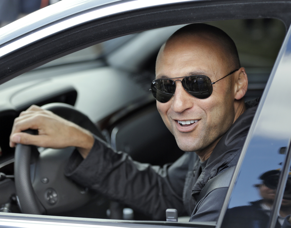 BACK AT IT: New York Yankees shortstop Derek Jeter smiles as he leaves after practicing at the baseball team's minor league facility Thursday, Feb. 13, 2014, in Tampa, Fla. Jeter announced that he will be retiring after the 2014 season.