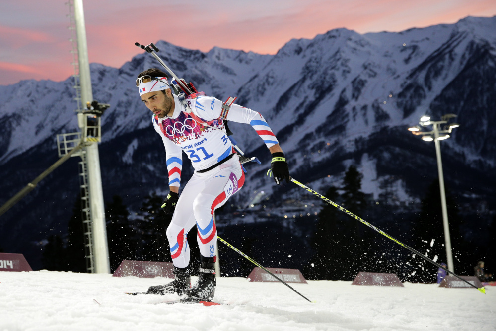 France's Martin Fourcade competes during the men's biathlon 20k individual race at the 2014 Winter Olympics, Thursday, Feb. 13, 2014, in Krasnaya Polyana, Russia. Fourcade won the gold medal.