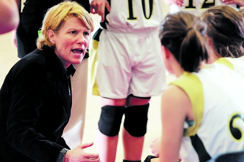 Original: Staff photo by Joe Phelan DRAW UP WINNING PLAN: Rangeley coach Heidi Deery talks to her team during a Western Maine Class D quarterfinal Tuesday at the Augusta Civic Center. Rangeley beat Kents Hill 50-26.