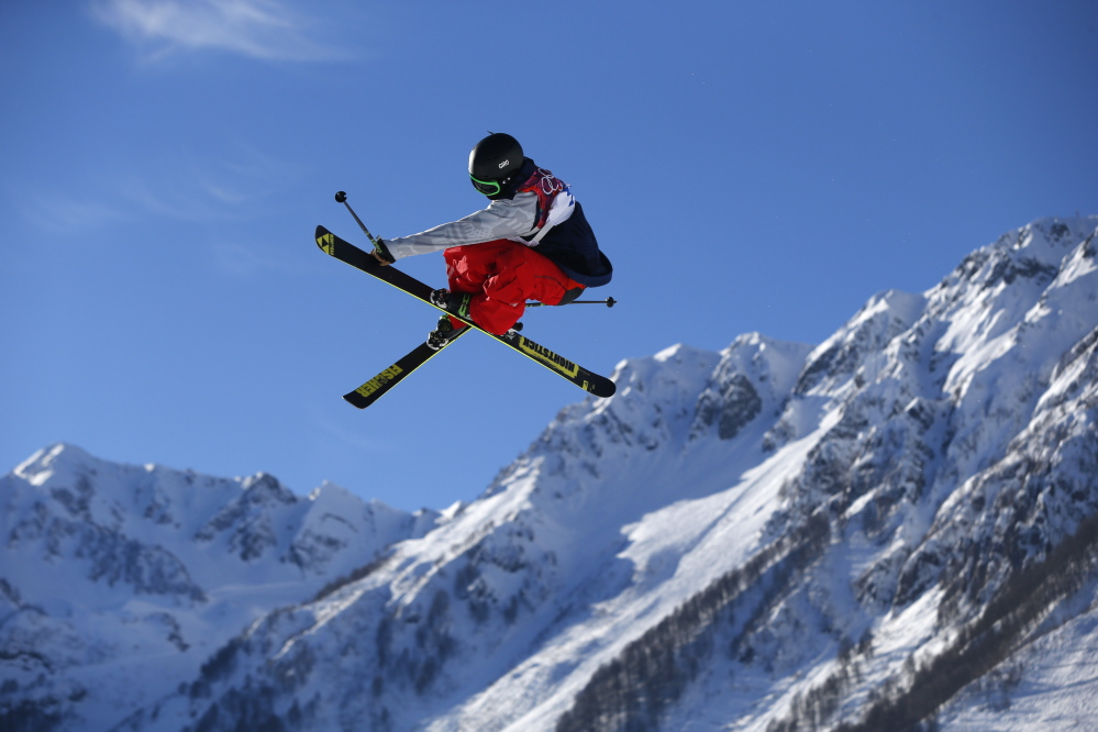 Joss Christensen of the United States competes in the men's ski slopestyle qualifying at the Rosa Khutor Extreme Park. Christensen's three off-axis jumps at the end of his first qualifying run totaled 10 full spins in the span of 15 seconds — all coming while he skied over the ramp backward.