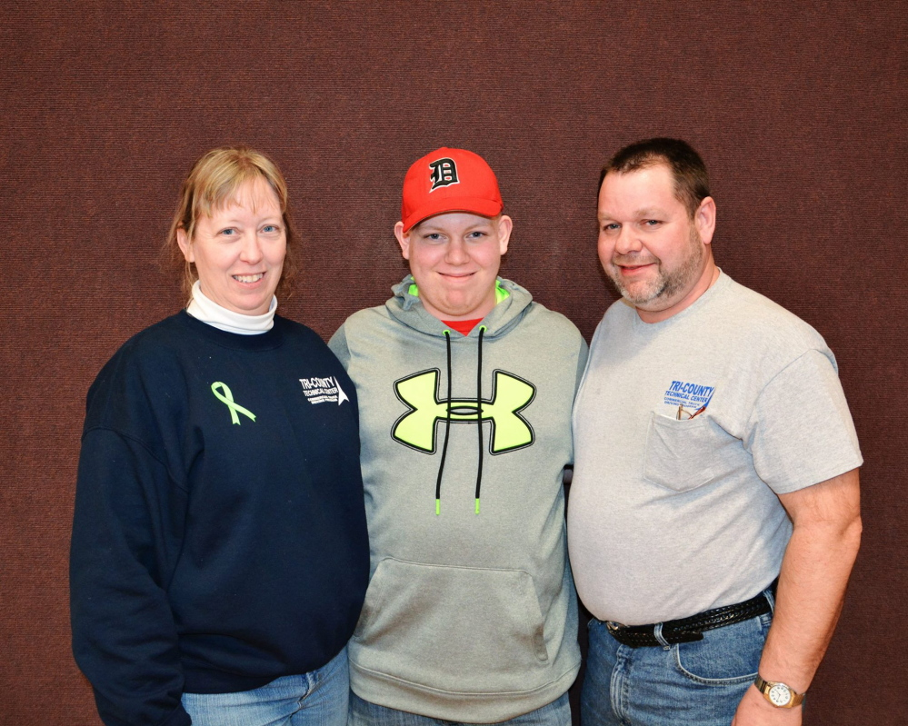 HELPING LOGAN: Gloria, Logan and Brian Bagley attend a benefit dinner in Harmony Jan. 25. Logan Bagley was recently diagnosed with Hodgkin lymphoma, a type of cancer.