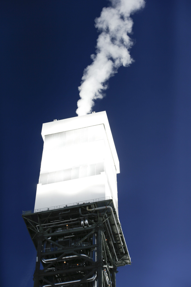 One of the boilers vents steam recently at the Ivanpah Solar Electric Generating System.