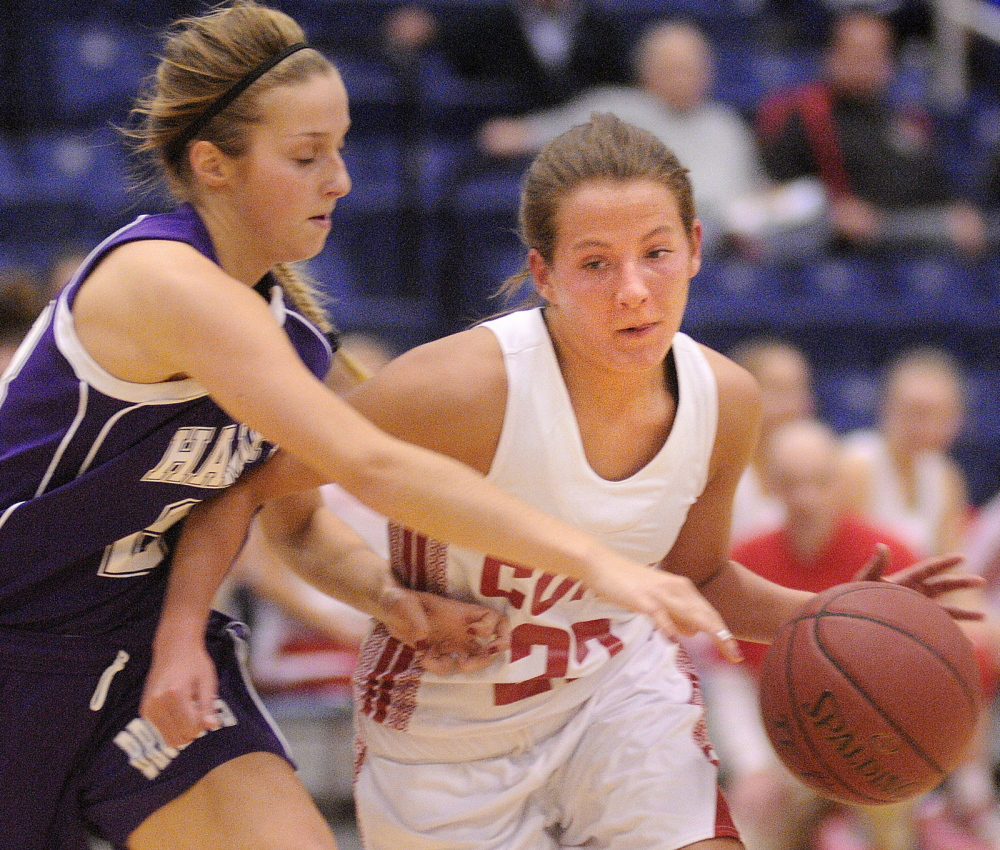 MOVE OVER: Cony High School's Hayley Quirion, right, dribbles past Hampden Academy's Elise Arsenault earlier this season in Augusta. No. 4 Cony takes on No. 5 Brunswick in the quarterfinals at 7 tonight at the Augusta Civic Center.