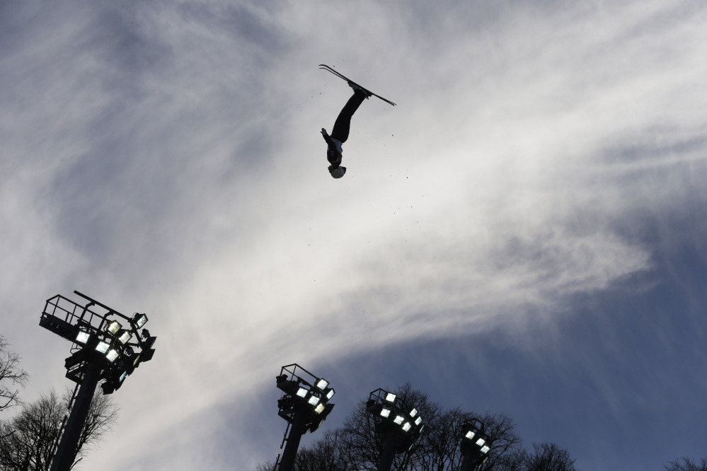 Ashley Caldwell of the United States jumps during the women's freestyle skiing aerials qualifying at the Rosa Khutor Extreme Park, at the 2014 Winter Olympics, Friday, Feb. 14, 2014, in Krasnaya Polyana, Russia.