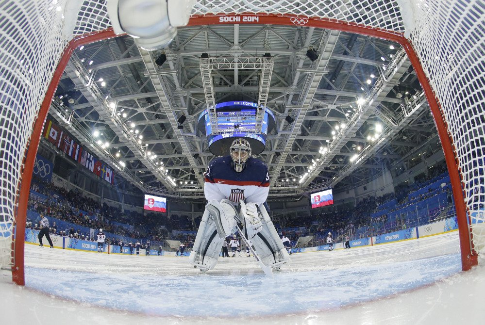 USA goaltender Jonathan Quick looks back into the net before the game against Slovakia during the men's ice hockey tournament at the 2014 Winter Olympics, Thursday, in Sochi, Russia.