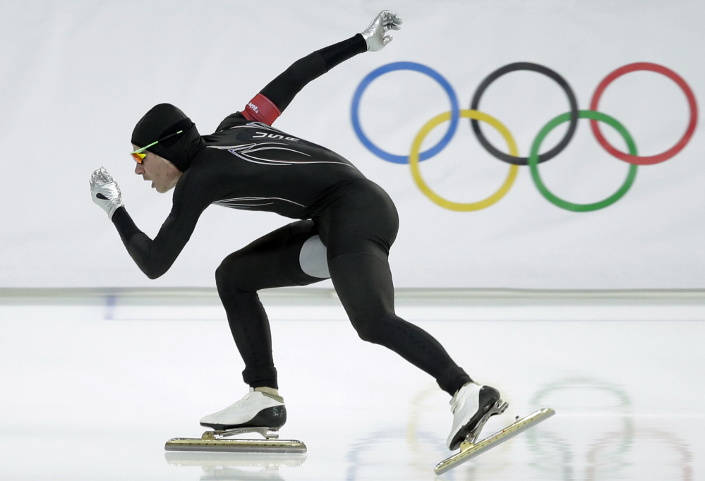 Tucker Fredricks of the United States competes in the first heat of the men's 500-meter speedskating race at Adler Arena in Sochi, Russia, on Feb. 10.