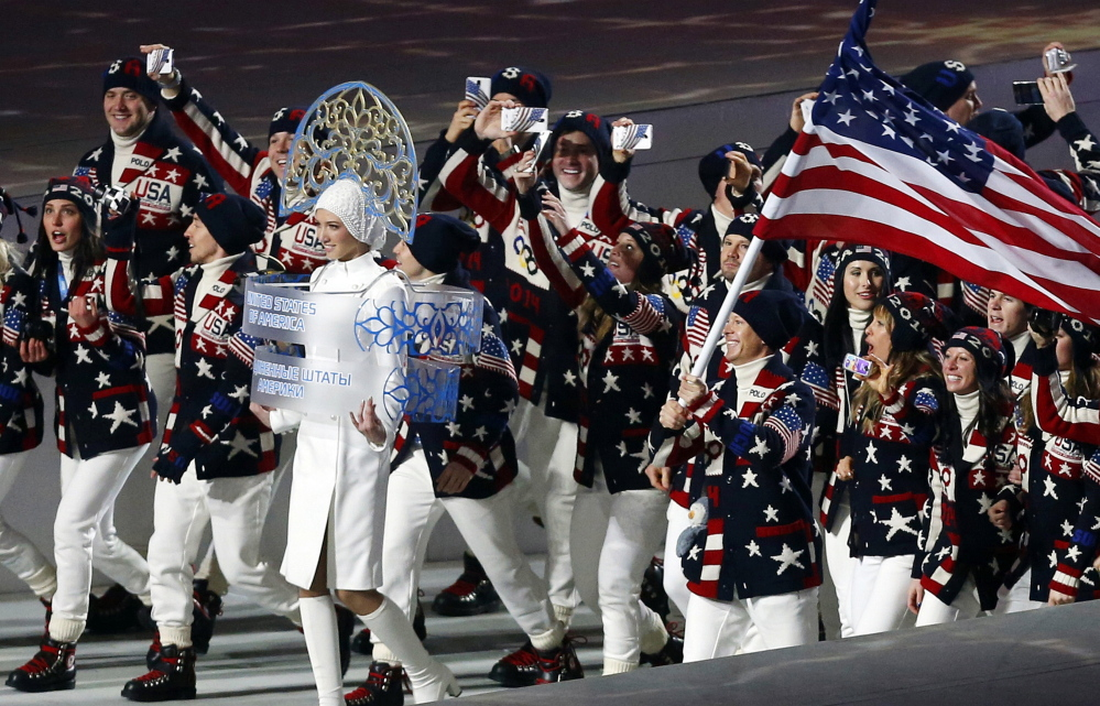Members of the United States Olympic team – many of them holding up mobile phones to record the moment – enter Fisht Stadium in Sochi, Russia, for the opening ceremony of the 2014 Winter Olympics on Feb. 7, 2014. Picking up new followers on Twitter, Facebook and other social media platforms is the smart play for Olympians at the Sochi Games. Athletes who share their experiences from their privileged backstage access at the games could come home from Russia with far stronger hands to woo and squeeze more money from sponsors.