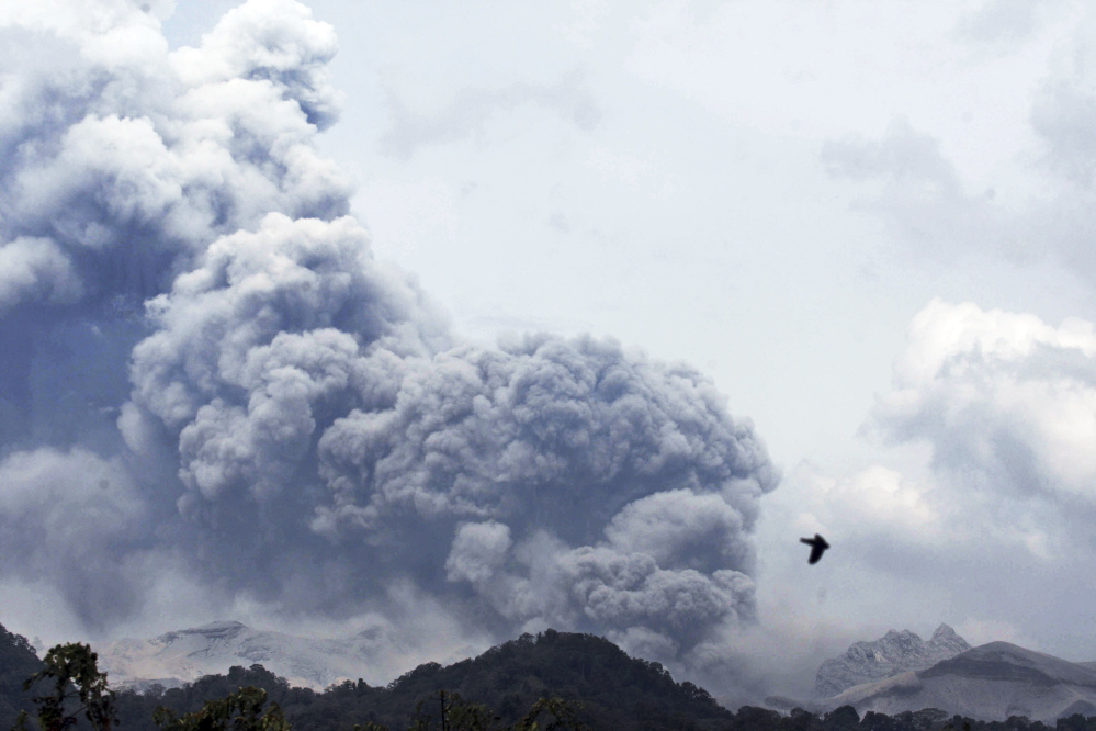 Mount Kelud erupts, as seen from Anyar village in Blitar, East Java, Indonesia on Friday. Volcanic ash shrouded a large swath of the country's most densely populated island, closing three international airports.