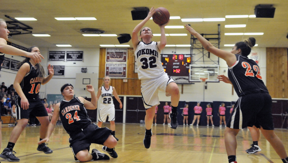 Staff photo by Michael G. Seamans Nokomis High School's Taylor Shaw, 32, drives to the basket against Gardiner High School in Newport on Wednesday.