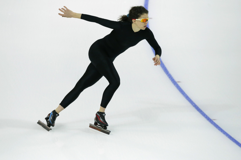 Maria Lamb of the U.S. skates in a black suit after changing her official US Speedskating team suit during a training session at the Adler Arena Skating Center at the 2014 Winter Olympics, Friday, Feb. 14, 2014, in Sochi, Russia. The team thought it had a chance to do something special, given some impressive World Cup results this season and new high-tech suits from Under Armour, which got an assist in the design from aerospace giant Lockheed Martin. Now, there's plenty of grumbling that the suits are actually slowing the skaters down in Sochi.