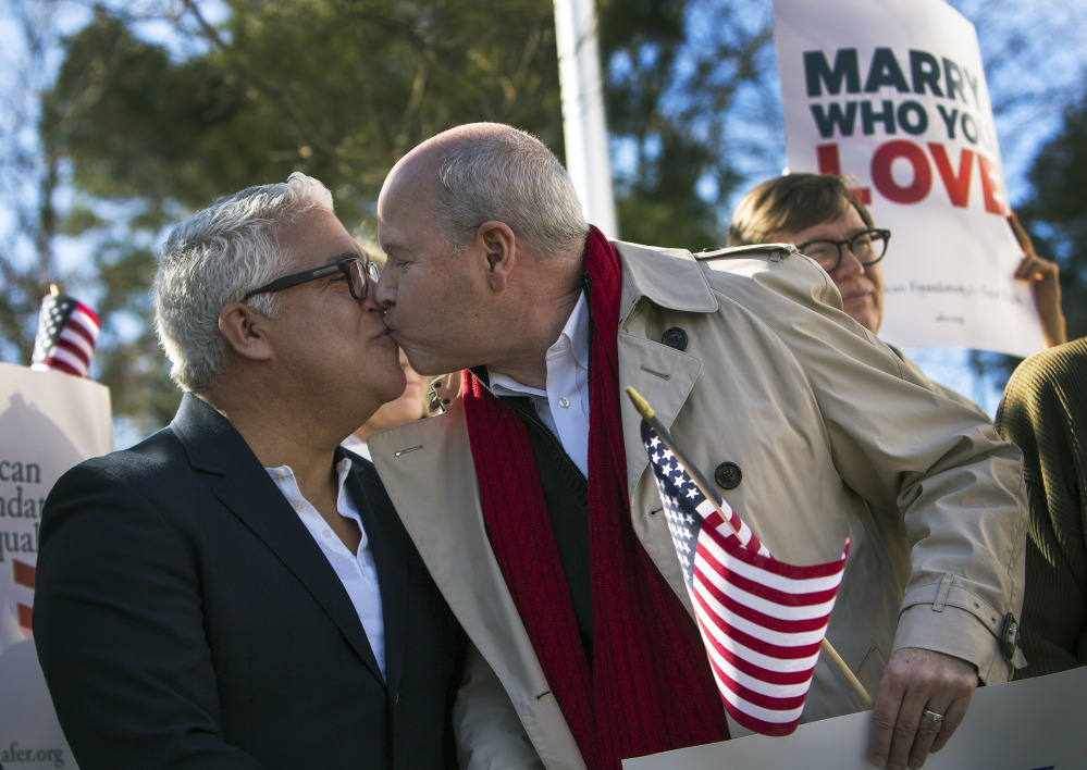 From left, Robert Roman and Claus Ihlemann of Virginia Beach celebrate Thursday's ruling by federal Judge Arenda Wright Allen that Virginia's same-sex marriage ban was unconstitutional during a news conference Friday in Norfolk, Va.