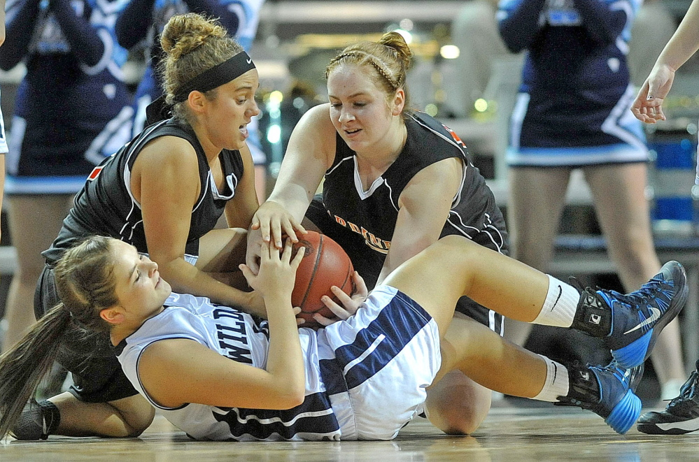 GET AFTER IT: Gardiner Area High School's Nicole Chadwick, left, and Rachel Quirion (15) battle for a loose ball with Presque Isle High School's Krystal Kingsbury in the first quarter of an Eastern Class B quarterfinal game Saturday at Cross Insurance Center in Bangor.