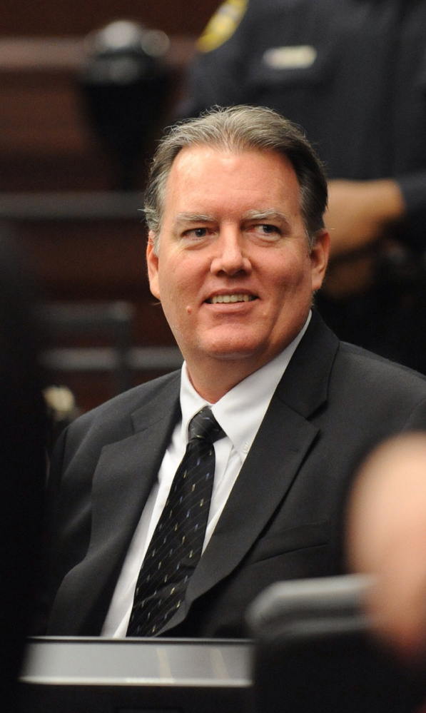 Michael Dunn smiles during a break in his trial Wednesday in Jacksonville, Fla. He was found guilty of three counts of attempted murder.