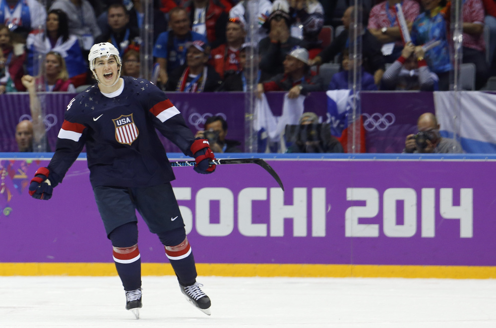 USA forward T.J. Oshie reacts after scoring the winning goal in a shootout against Russia during overtime of a men's hockey game at the 2014 Winter Olympics on Saturday in Sochi, Russia.
