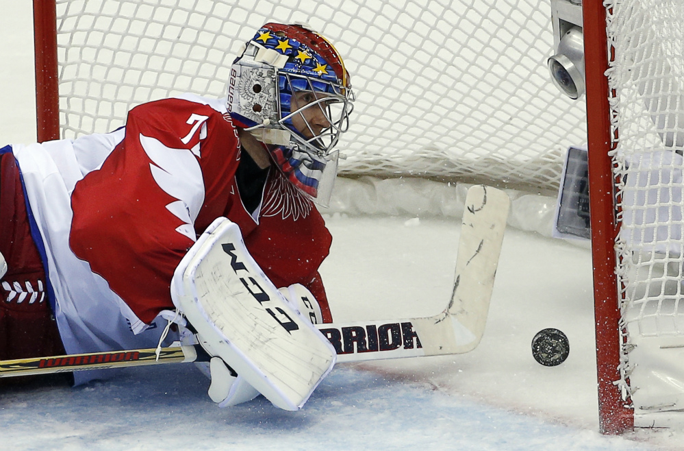 Russia goaltender Sergei Bobrovski watches the puck bounce back off the net after a goal by the USA in the second period of a men's hockey game at the 2014 Winter Olympics on Saturday.