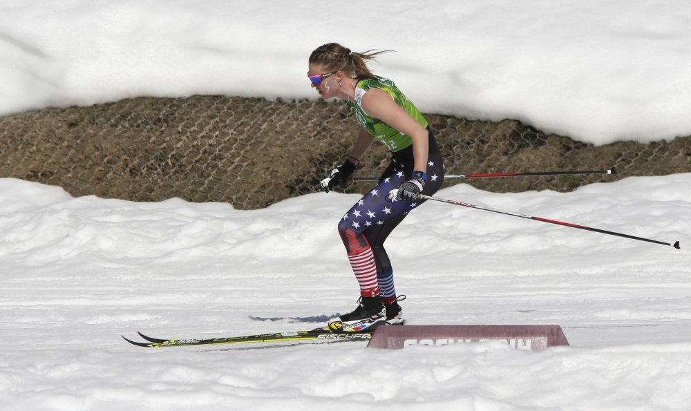 United States' Sadie Bjornsen skis in a sleeveless top past a hole in the snow during the women's 4x5K cross-country relay.