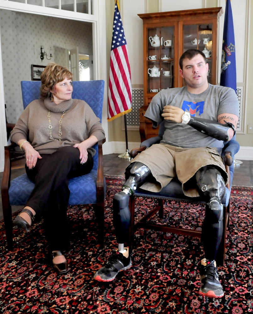 INSPIRED: First lady Ann LePage listens to Travis Mills talk on Wednesday at the Blaine House in Augusta about the effort to raise money for a recreation center on Salmon Lake in Belgrade for wounded warriors. The site's purpose would be to help the veterans recover from their injuries.