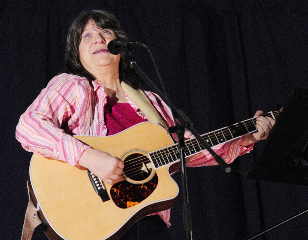 Navy veteran: Beth Revels performs a song during the 2014 Maine Veterans Creative Arts Festival on Saturday in the Togus auditorium. The event was presented by VA Maine Healthcare System-Togus and the Maine American Legion Auxiliary.