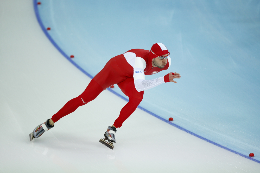 Gold medalist Poland's Zbigniew Brodka competes in the men's 1,500-meter speedskating race at the Adler Arena Skating Center during the 2014 Winter Olympics in Sochi, Russia on Saturday.