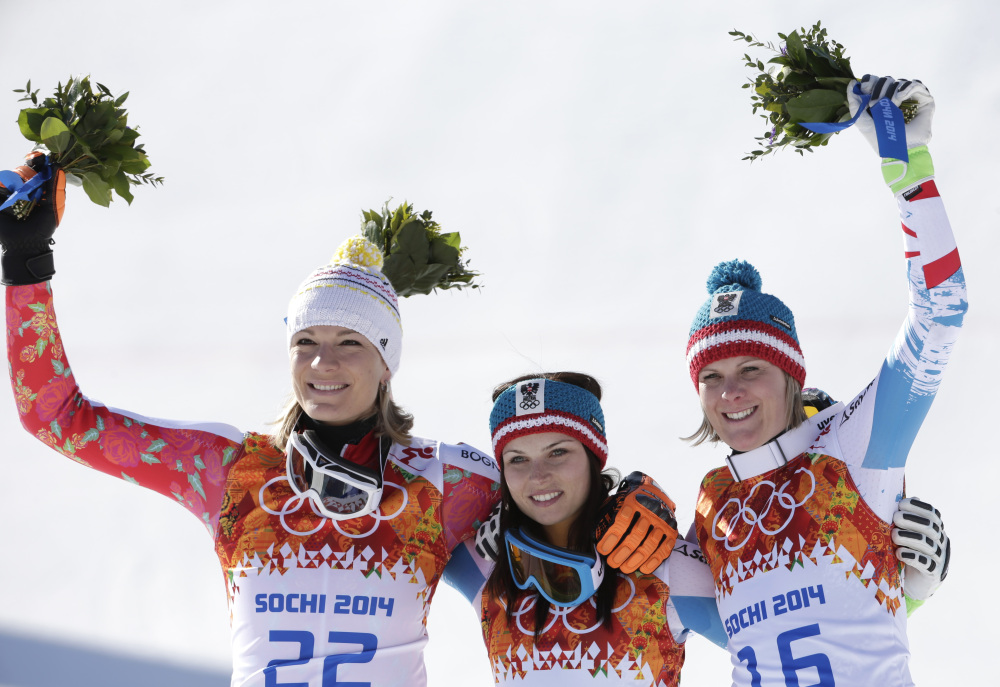 Women's super-G medalists from left, Germany's Maria Hoefl-Riesch (silver), Austria's Anna Fenninger (gold) and Austria's Nicole Hosp (bronze) pose for photographers on the podium at the Sochi 2014 Winter Olympics Saturda in Krasnaya Polyana, Russia.