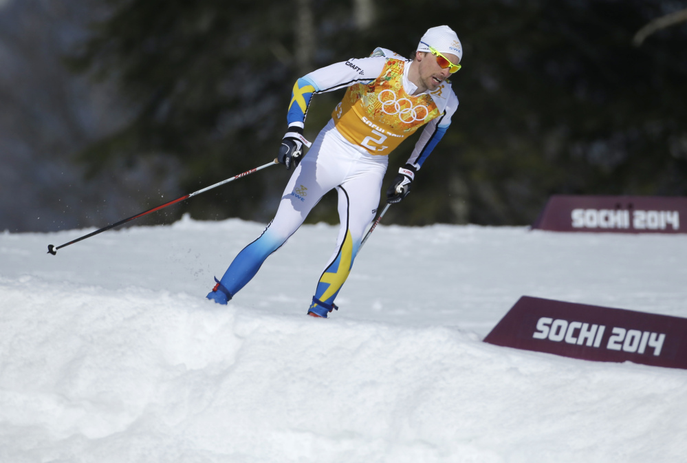 Sweden's Johan Olsson skis during the men's 4x10K cross-country relay at the 2014 Winter Olympics Sunday in Krasnaya Polyana, Russia.