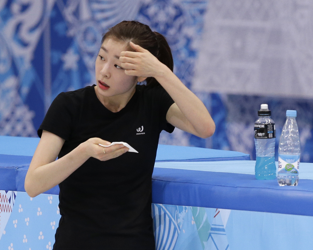 Yuna Kim of South Korea wipes her face during a practice session at the Iceberg Skating Palace during the 2014 Winter Olympics Sunday.