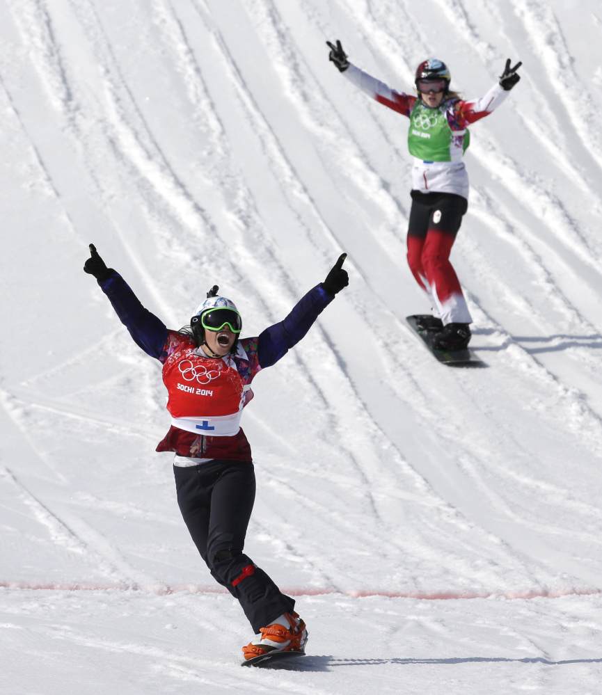 Czech Republic's Eva Samkova celebrates after taking the gold medal in the women's snowboard cross final, ahead of silver medalist Dominique Maltais of Canada, right, at the Rosa Khutor Extreme Park, at the 2014 Winter Olympics Sunday.