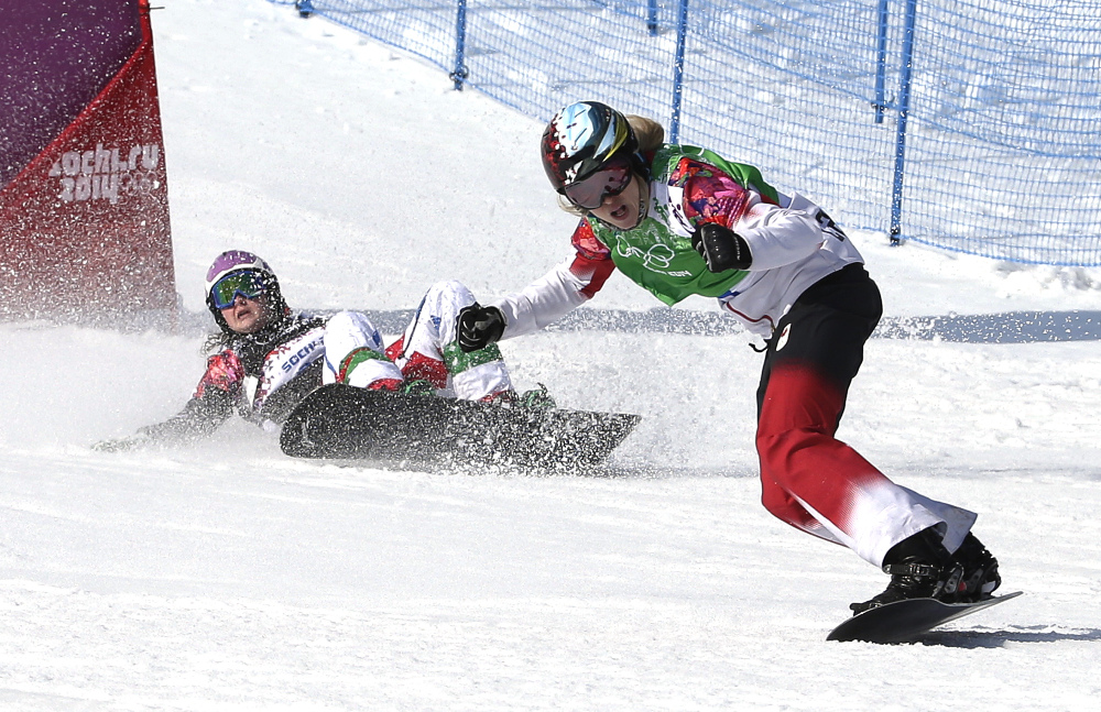 Canada's Dominique Maltais, right, reacts after winning the semifinal of the women's snowboard cross competition at the Rosa Khutor Extreme Park.