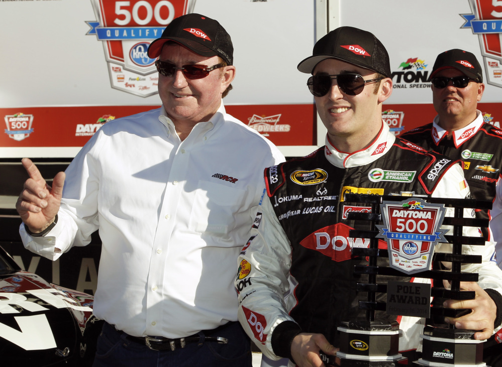 Austin Dillon, right, holds up the pole award with car owner and grandfather Richard Childress after qualifying for the pole position in the Daytona 500 NASCAR Sprint Cup Series auto race at Daytona International Speedway in Daytona Beach, Fla., on Sunday.