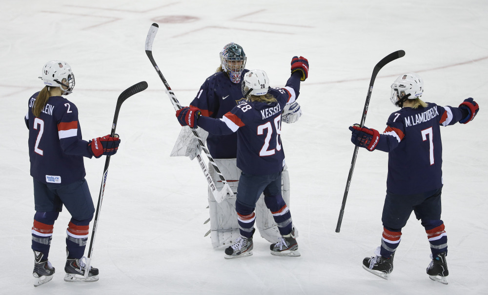 USA Goalkeeper Jessie Vetter and Amanda Kessel meet near mid ice with Lee Stecklein and Monique Lamoureux after defeating Sweden 6-1 during a 2014 Winter Olympics women's semifinal ice hockey game at Shayba Arena on Monday in Sochi, Russia.